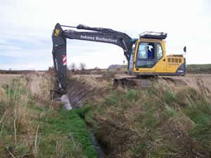 Bob the Digger Operator Cleaning out a ditch